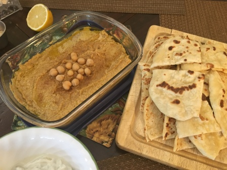 The whole presentation of hummus and flat bread