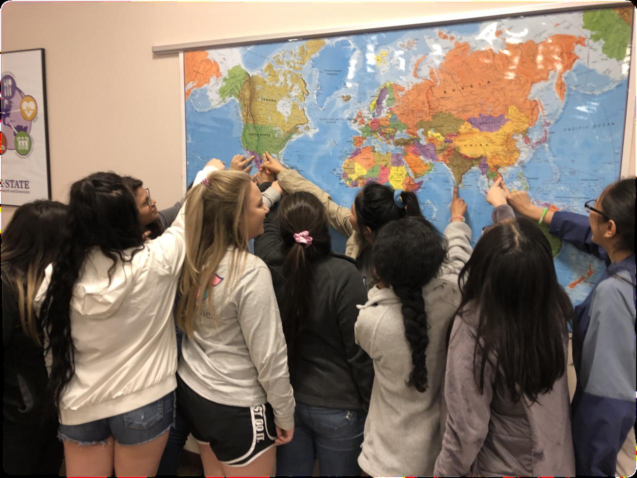 Girls pointing at map.jpg